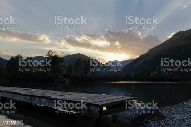 Photo of Light rays and flares obve a lake in south fracne during sunset