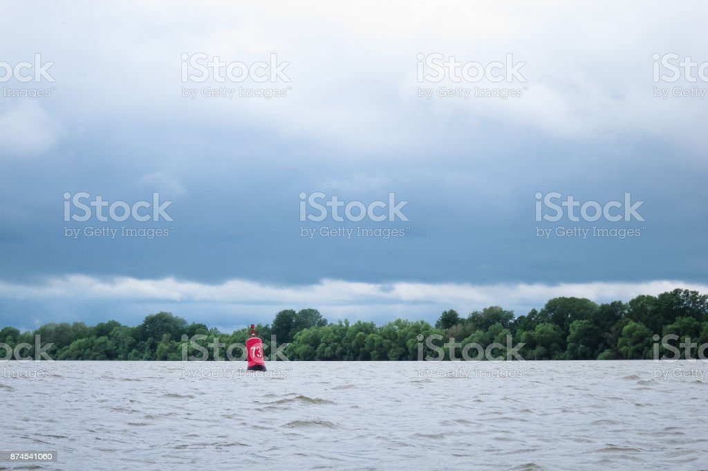 Light red beacon, bui, buoy in the Danube River stock photo