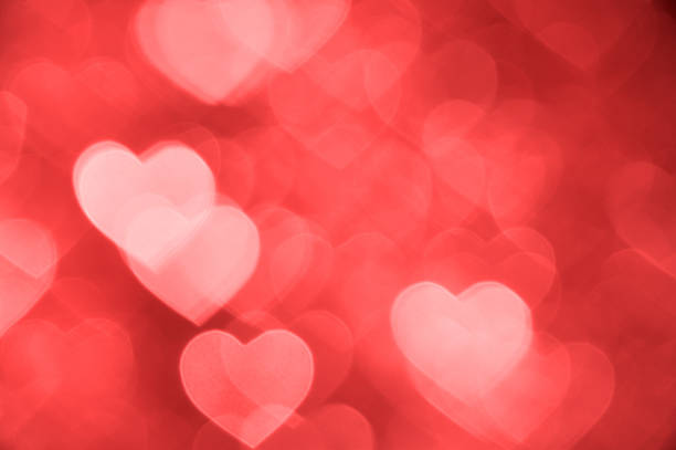 light red heart bokeh background photo, abstract holiday backdrop - foto de stock