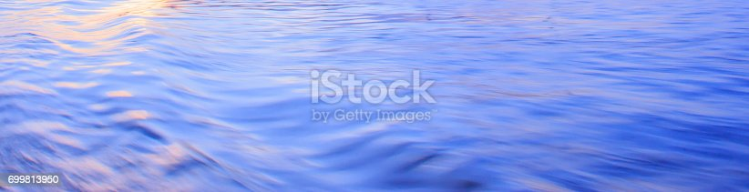 istock Light reflection on blue river wave ripples surface. Abstract, tranquility,romance. 699813950