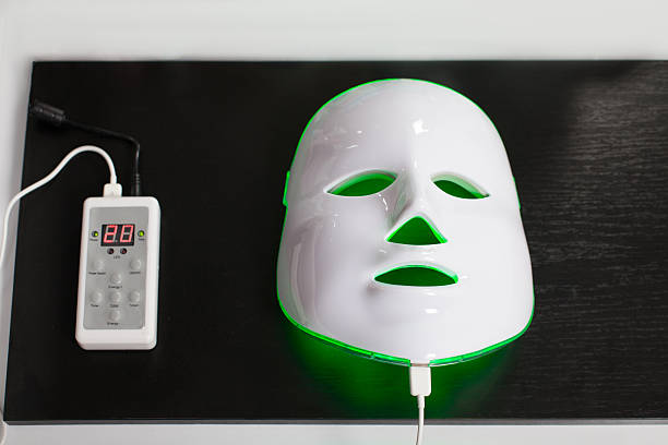Light rejuvenating mask for facial skin therapy. stock photo