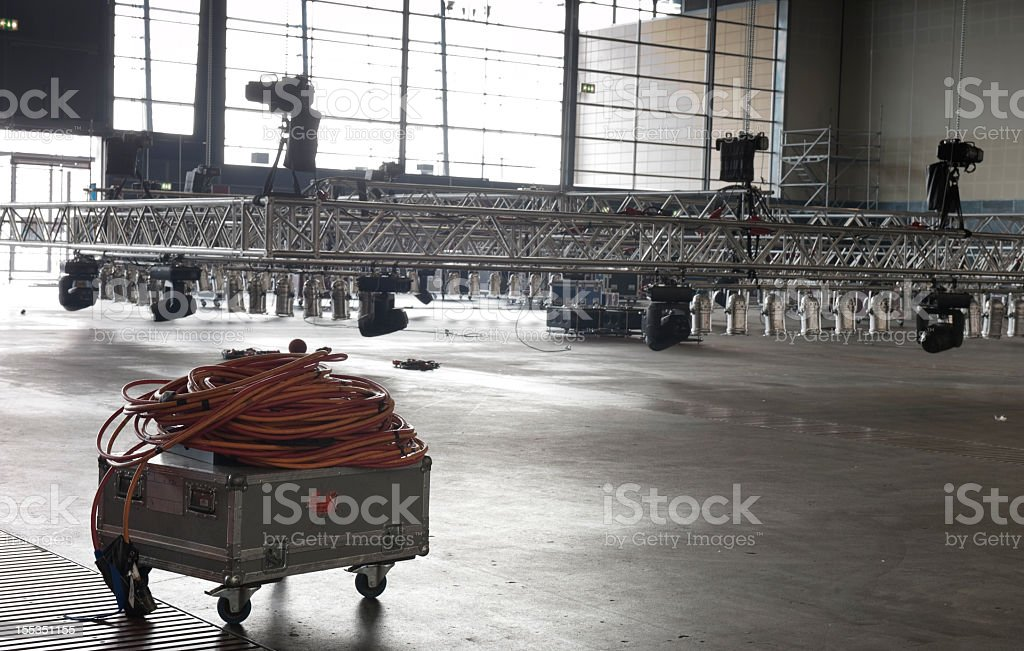 Light scaffolding and power cords in a large venue stock photo