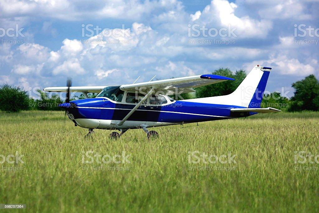 Light school airplane on grass stock photo