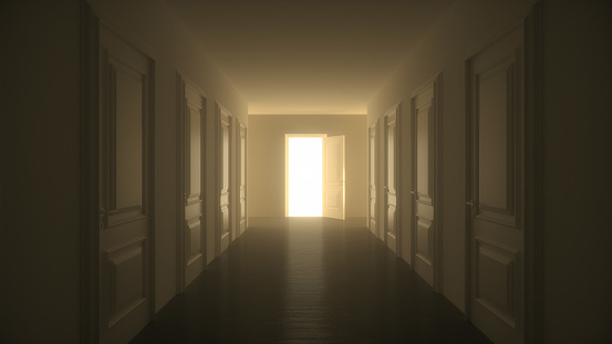 Light shines from door opening in dark room corridor. Fills the space with bright white light. Long corridor with closed doors. Success concept. 3D render