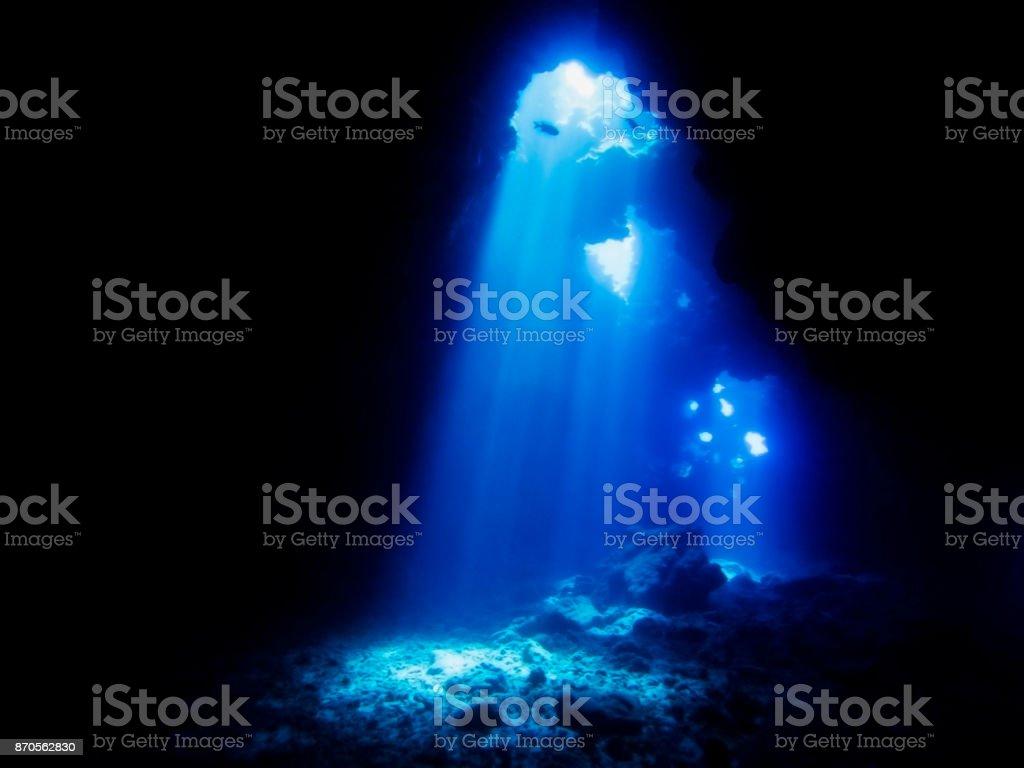 Light Shines through Lava Cave Underwater stock photo