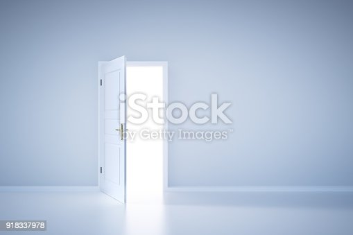 922736714 istock photo Light shining from open door. Entrance 918337978