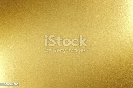istock Light shining on gold metal board, abstract texture background 1160004663