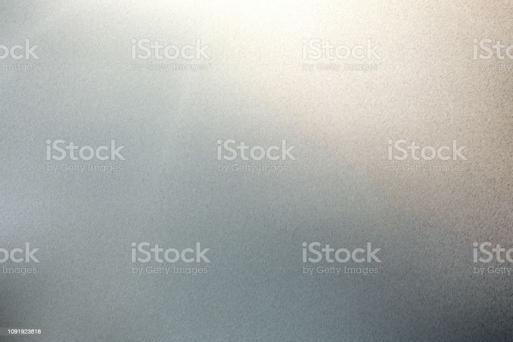 Light shining on rough gray metal floor texture, abstract background