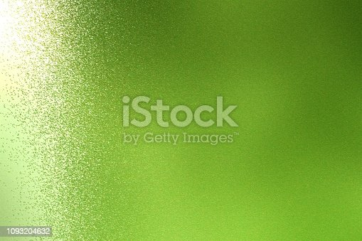 Light shining on rough green metal wall texture, abstract background