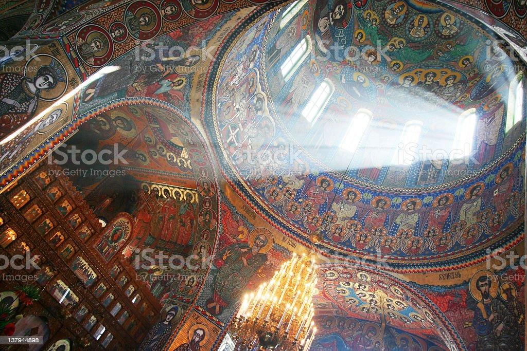 Light shining through architecture with biblical images stock photo