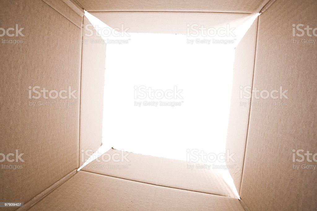 Light shining through the open end of an empty cardboard box royalty-free stock photo