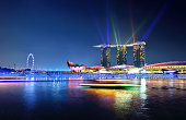 Singapore, Singapore - December 23, 2015: Light show at marina bay in night, The ball in the water was dyed in various