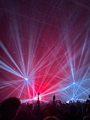 Light show at the concert. Laser beams and light music