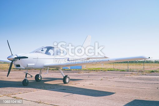 Light single-engine aircraft at the airport. Front view