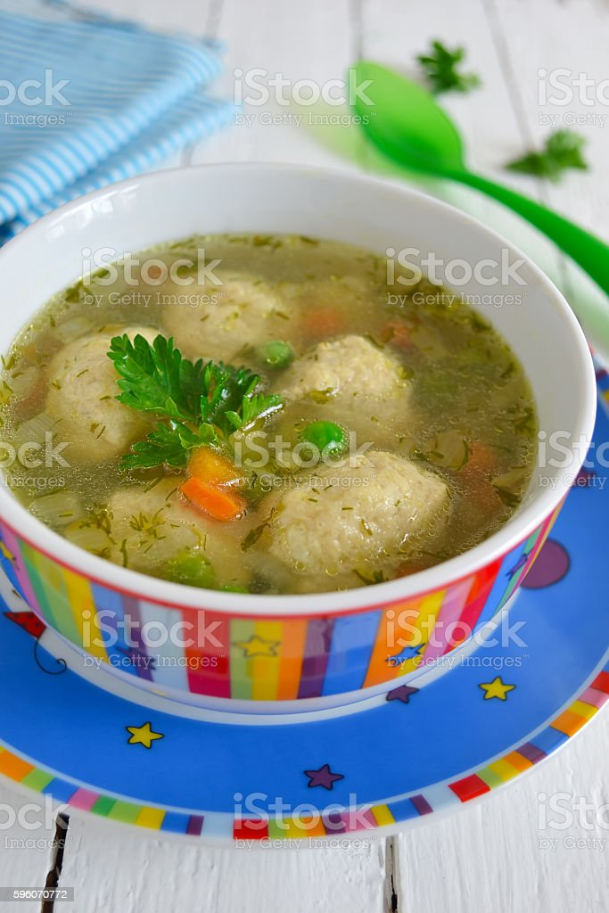 Light soup with meatballs and green peas, dinner for children royalty-free stock photo