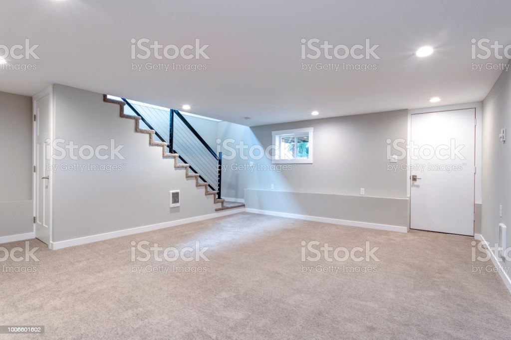 Basement Stair Lighting Pendant: Light Spacious Basement Area With Staircase Stock Photo