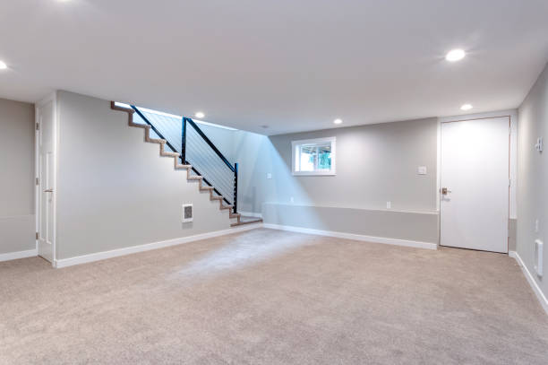 Light spacious basement area with staircase. stock photo