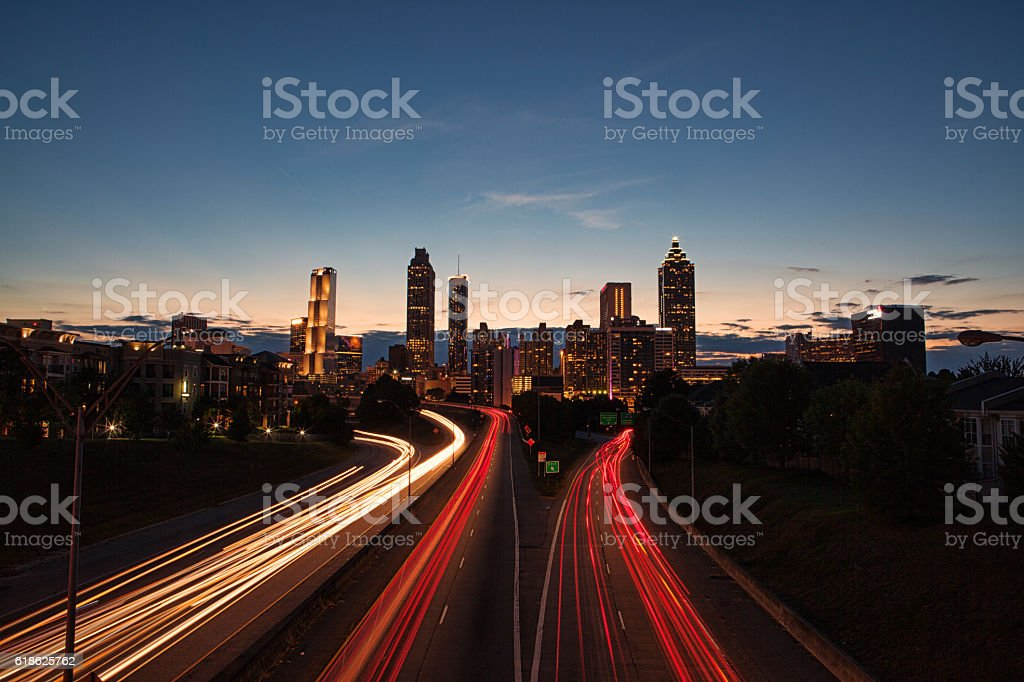Light streaks through the Atlanta highways at blue hour stock photo