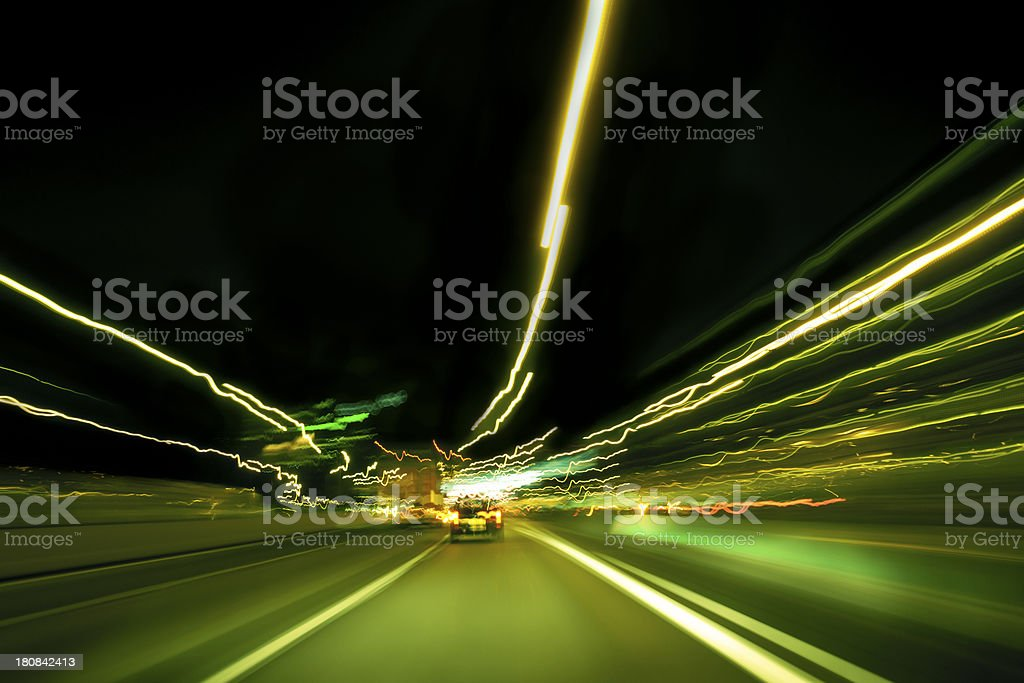 light streams across a road at night royalty-free stock photo