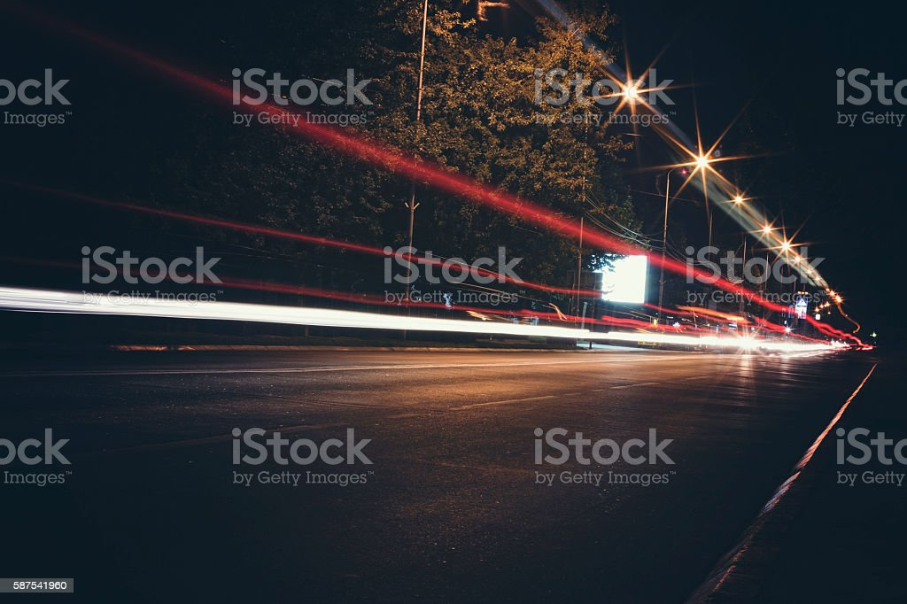 Light streams from ongoing traffic stock photo