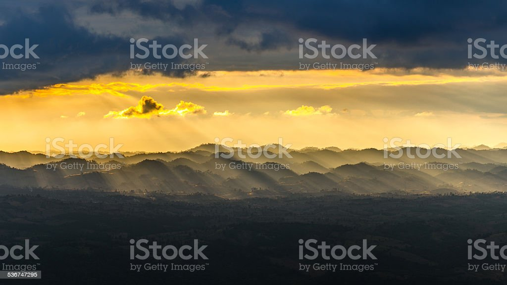Light sunset in the mountains stock photo