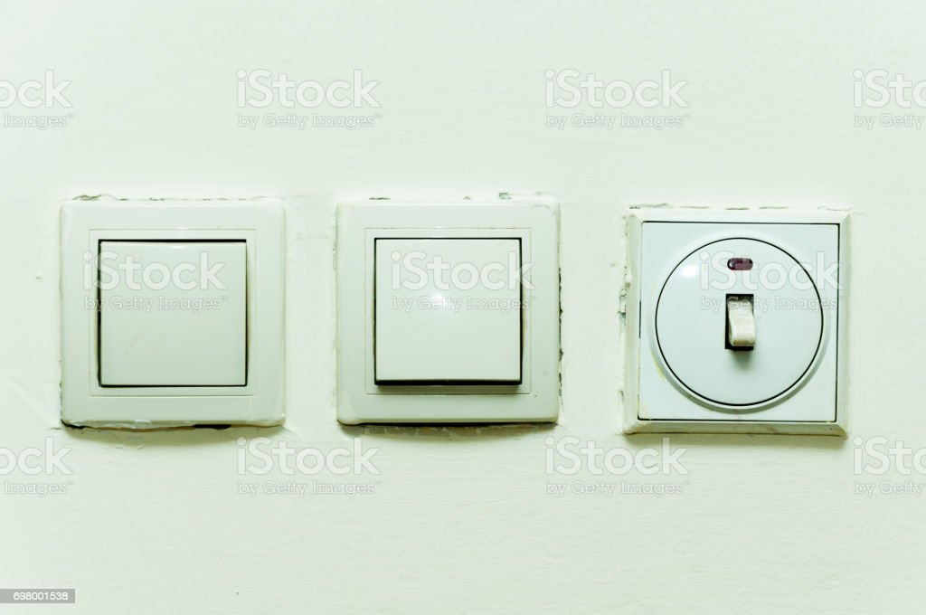 Light switches on the wall. stock photo