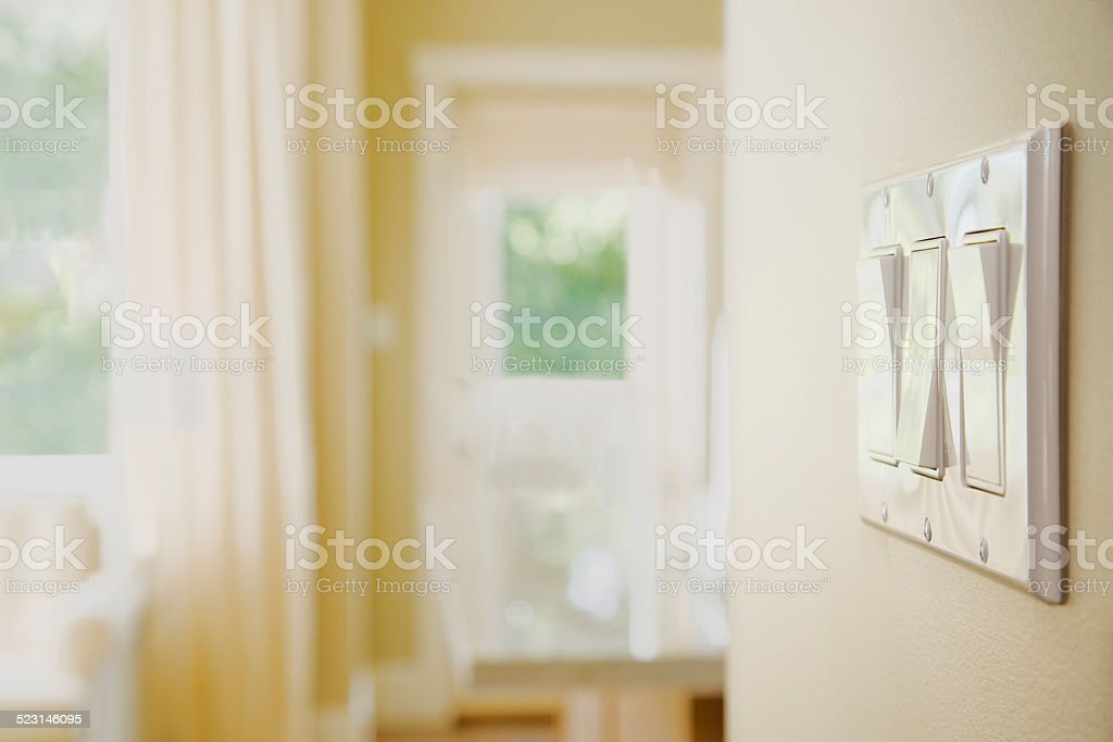 Light switches on wall stock photo