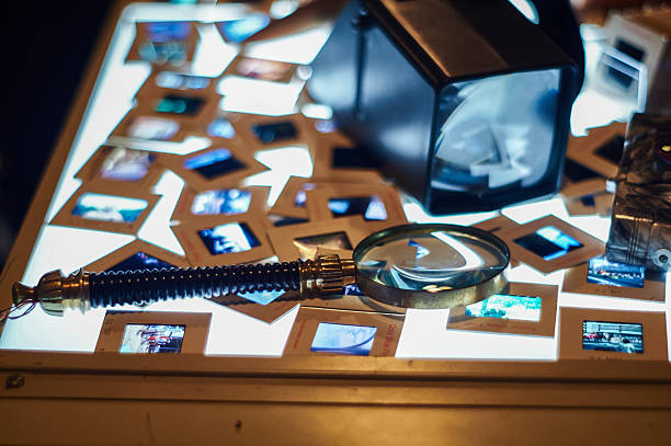 light table with magnifying glass and slides stock photo