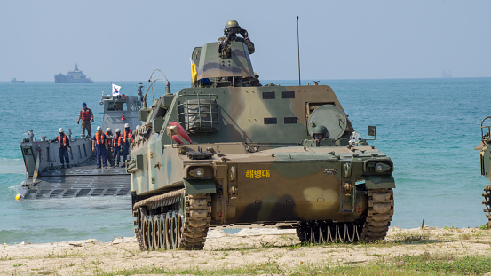 istock A light tank of South Korea marine is carried by Landing craft to the shore. 946729586