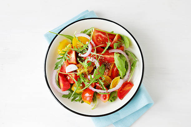light tomato salad with arugula stock photo