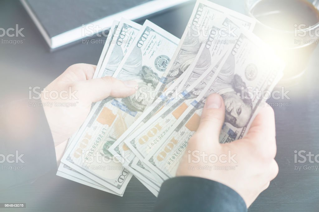 Light toning hand recount dollars. the man counts the money. new hundred-doll royalty-free stock photo
