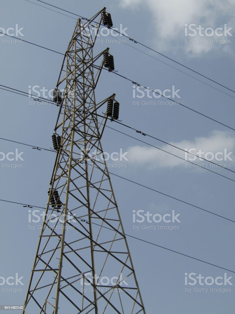 Light Towers - Outdoor sports lighting towers and cloudy blue sky. stock photo