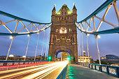 Light trail in Tower Bridge at dusk, London, UK