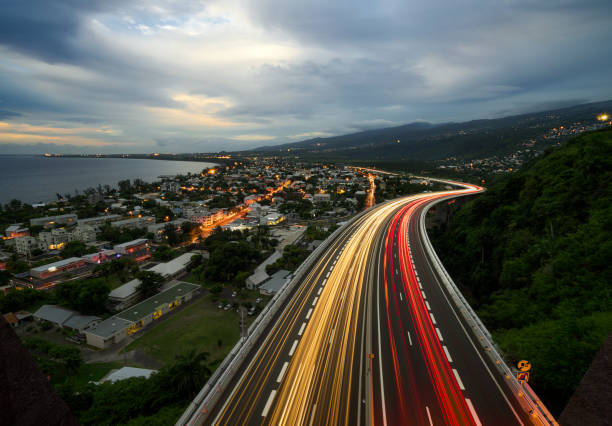 Light trail of cars on the tamarin road in Saint Paul, Reunion Island stock photo