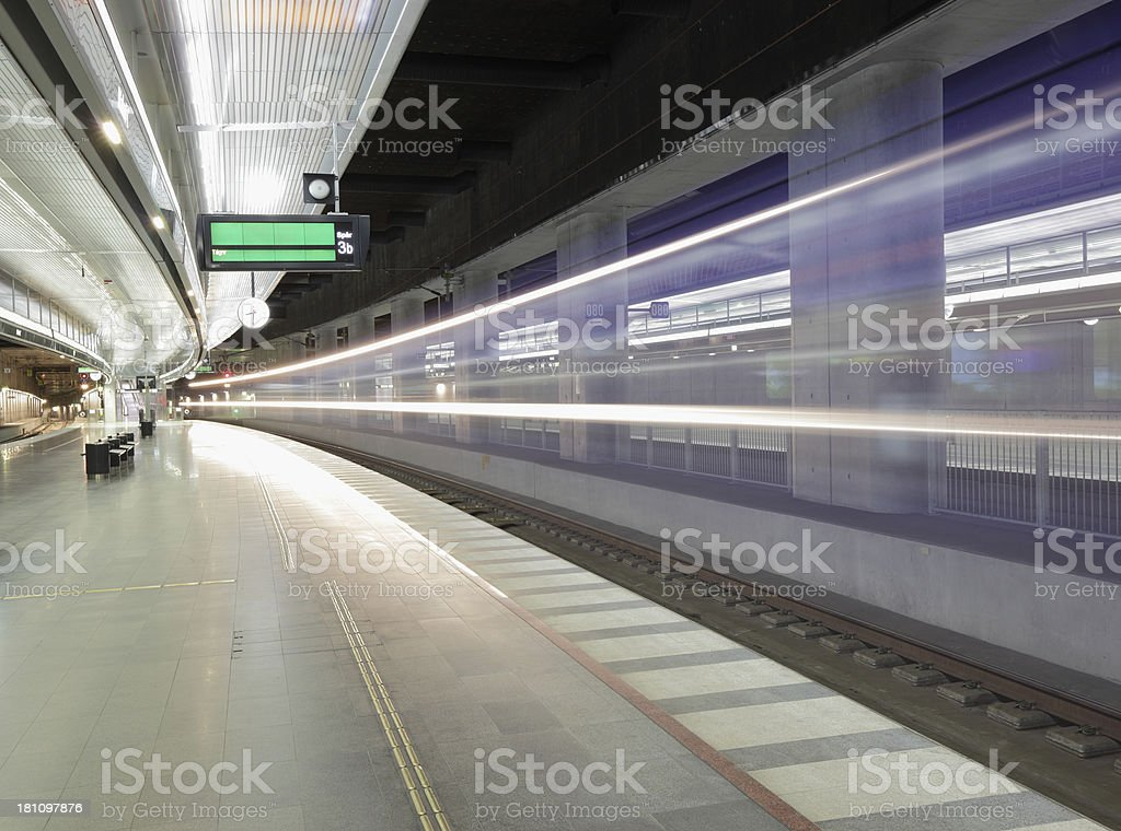 Light trail of train passing station royalty-free stock photo