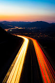 A long exposure of car light trails at sunset near San Marcos, California