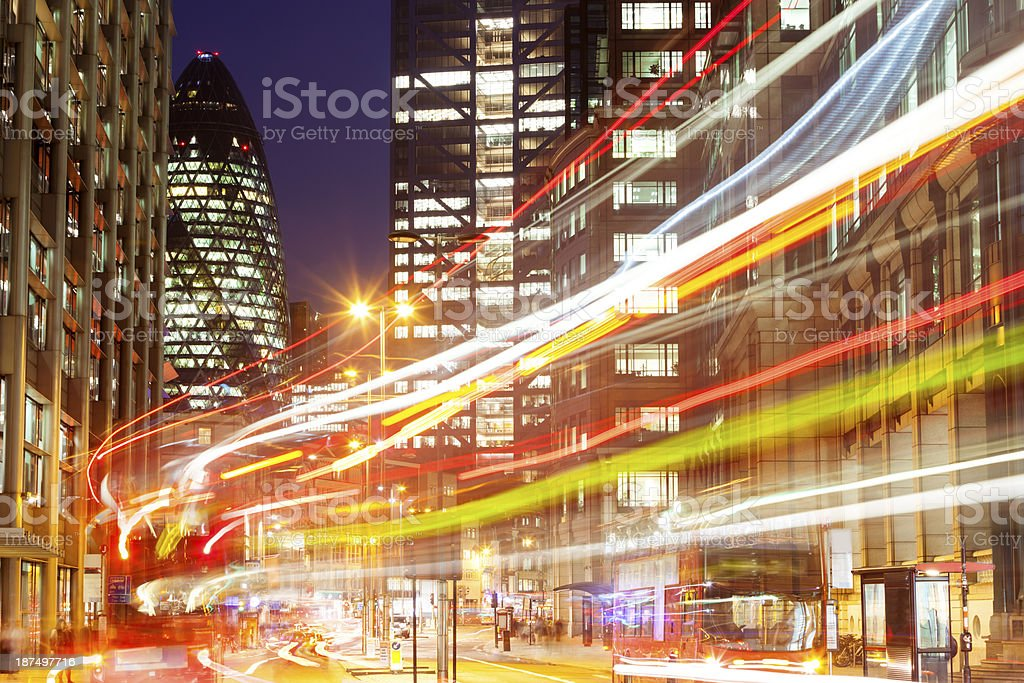 Light Trails From Buses Travelling Along London`s Street at Night stock photo