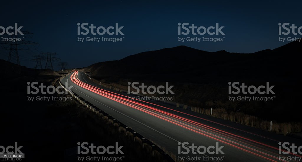 Light trails from fast moving cars stock photo