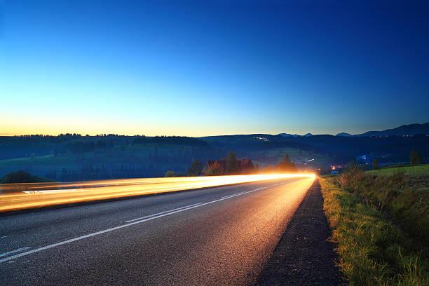 Light trails - mountain road stock photo