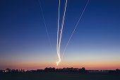 Light trails of airplane during landing at airport after sunset. Prague, Czech Republic.