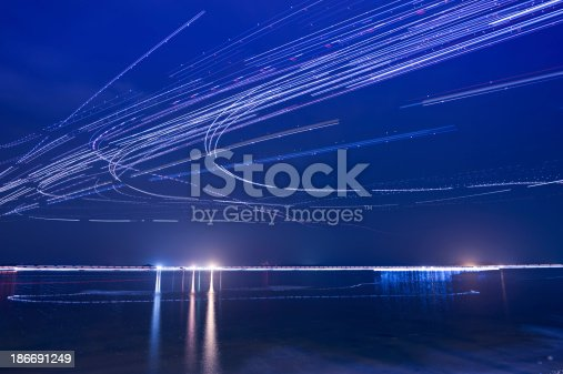istock Light trails of Airplanes 186691249