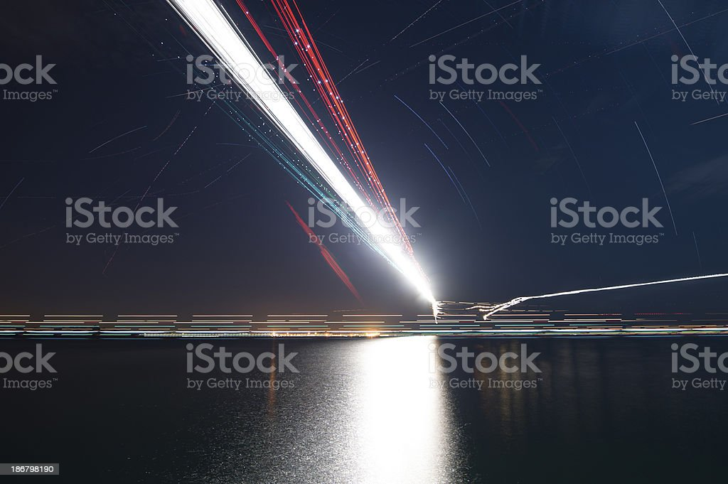 Light trails of Airplanes stock photo