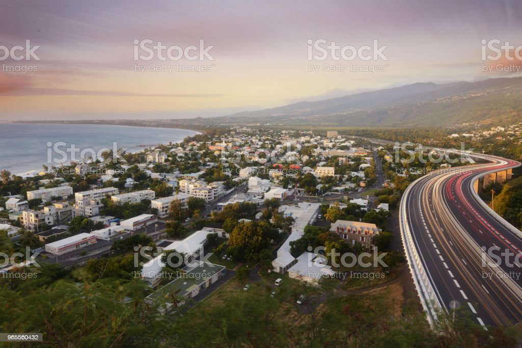Light trails of cars on the tamarin road in Saint Paul, Reunion Island stock photo