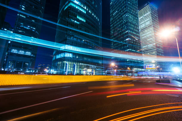 Light trails on modern building background in shanghai stock photo