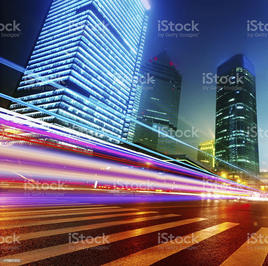 light trails on the modern building background in shanghai stock photo