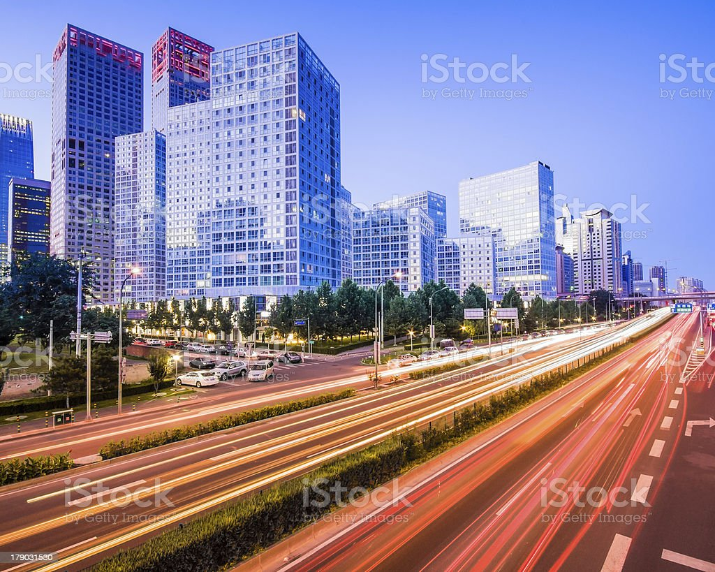 light trails on the modern city at dusk in beijing royalty-free stock photo