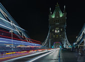 Light trails on Tower bridge at night, London, England.