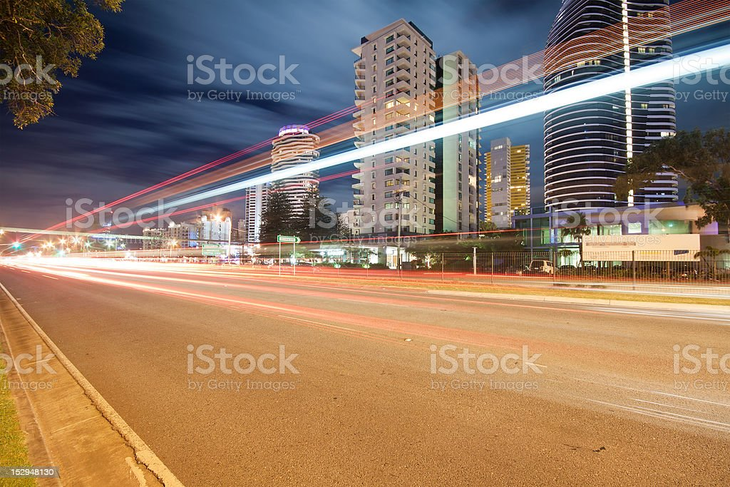 light trails over modern city at night royalty-free stock photo