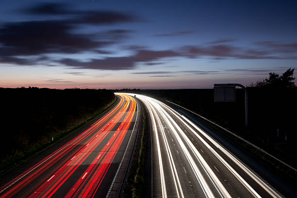 Light trails The light trails on the motorway multiple lane highway stock pictures, royalty-free photos & images