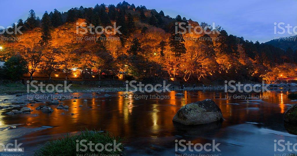 light up autumn landscape in twilight at Korankei, Japan stock photo